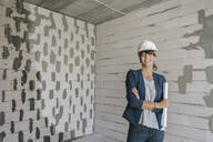 Portrait of female architect on construction site - AHSF00840