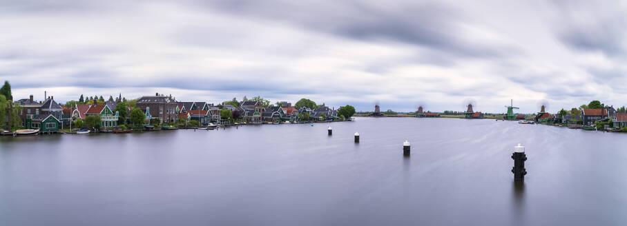 Panoramic shot of Zaan river against cloudy sky, Zaanse Schans, Zaandam, Netherlands - XCF00200