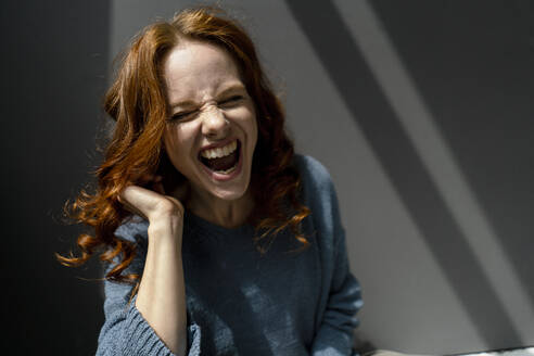 Portrait of redheaded woman laughing - KNSF06455