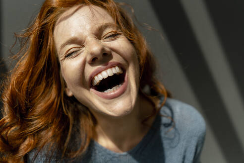 Portrait of laughing redheaded woman - KNSF06458