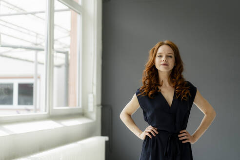 Portrait of redheaded businesswoman  in a loft - KNSF06482