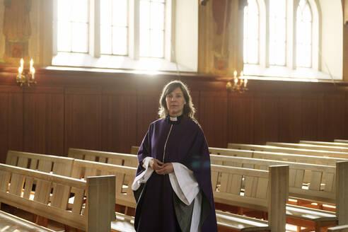 Portrait of priest in purple robes in church - FOLF11243