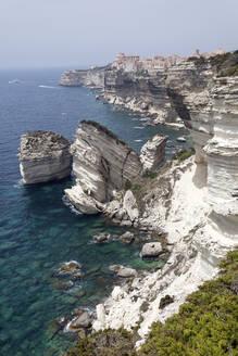 White Limestone Cliffs against clear sky at Bonifacio, Corsica, France - ZCF00800