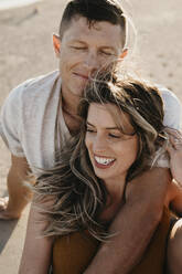Happy affectionate young couple on the beach - LHPF00830