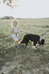 Girl going walkies with dog in the countryside - DWF00491