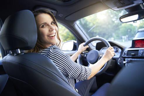 Happy woman driving car - PNEF01974