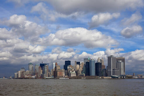 Downtown Manhattan Skyline seen from New Jersey against cloudy sky, New York City, USA - XCF00206