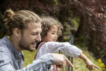 Happy father with son in garden - MJFKF00026