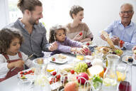 Happy extended family having lunch at home - MJFKF00116