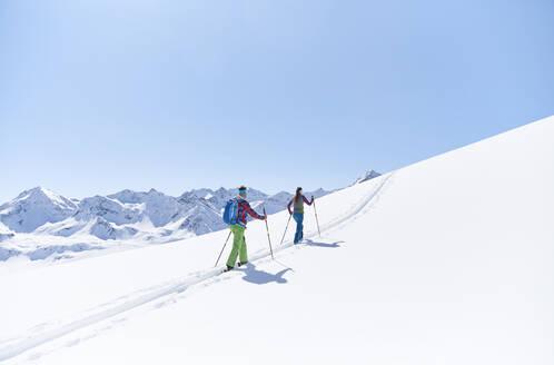 Couple ski touring in the mountains, Kuehtai, Tyrol, Austria - CVF01504