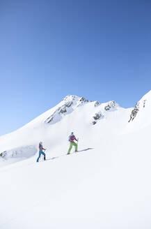 Couple ski touring in the mountains, Kuehtai, Tyrol, Austria - CVF01507