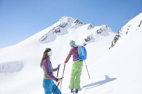 Couple ski touring in the mountains, Kuehtai, Tyrol, Austria - CVF01510