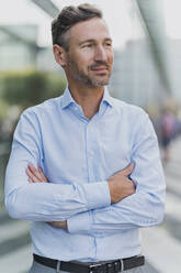 Portrait of confident businessman in the city - DIGF08426