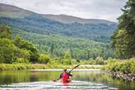 Canoeing the Caledonian Canal, near Fort Augustus, Scottish Highlands, Scotland, United Kingdom, Europe - RHPLF09213