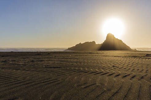 Scenic view of Karekare beach against sky during sunset, Auckland, New Zealand - FOF10901