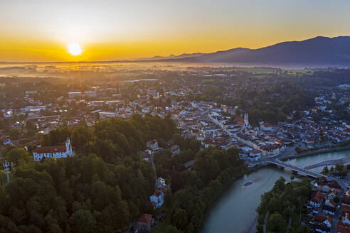 Aerial view of Bad Toelz against sky during sunrise, Isarwinkel, Germany - LHF00700