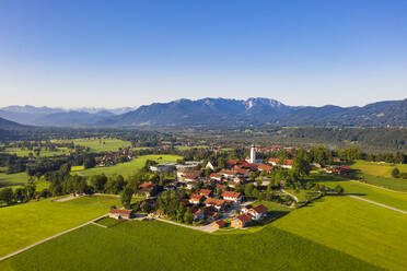 Aerial view of town and mountains against clear sky, Isarwinkel, Germany - LHF00709