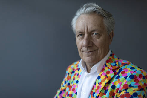 Portrait of a senior businessman wearing colorful sports jacket - GUSF02536