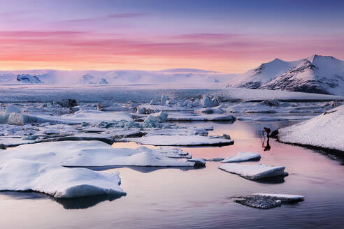 Scenic view of Jokulsarlon lagoon against sky during sunset, Iceland - XCF00211
