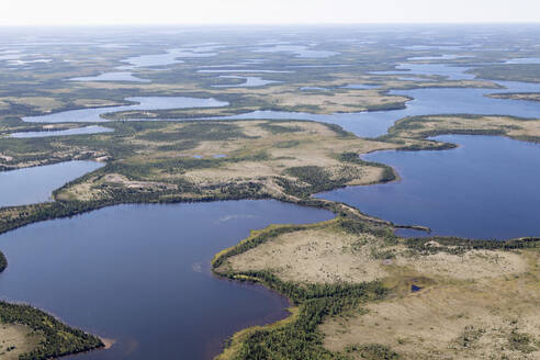 Aerial view of lakes and an esker, a ridge formed by sediment deposited during the last Ice Age, in northern Manitoba, Canada, North America - RHPLF10777