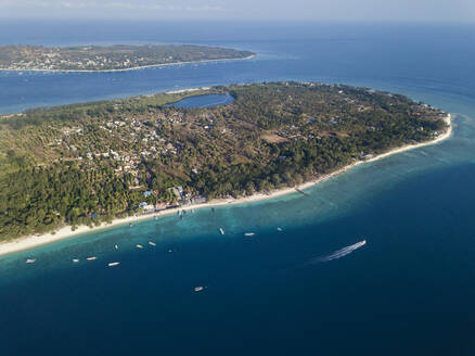 Aerial view of Gili Islands against sky during sunny day, Bali, Indonesia - KNTF03419