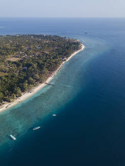 Aerial view of Gili Meno island against clear sky at Bali, Indonesia - KNTF03422