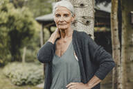 Senior woman standing in nature, portrait - JOSF03718