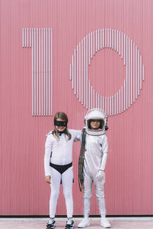 Two kids in astronaut and superhero costumes - DAMF00041