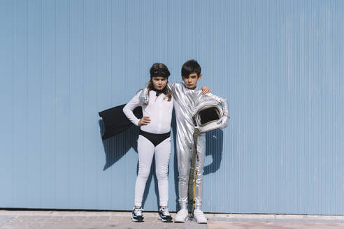 Two kids in astronaut and superhero costumes - DAMF00044