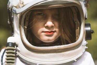 Portrait of girl wearing space helmet - DAMF00050