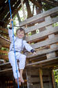 young, cool boy dressed as a superhero astronaut playing in a beautiful, tree house in the afternoon sun, lower austria, austria - HMEF00544