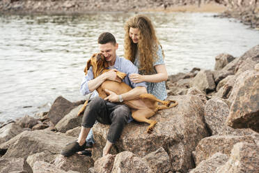 Young couple with dog at the beach - VPIF01500