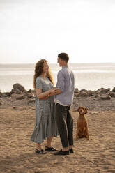 Young couple with dog at the beach - VPIF01518