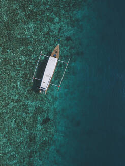 Drone view of outrigger on sea at Gili-Air Island, Bali, Indonesia - KNTF03438