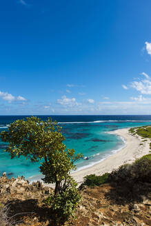 Scenic view of Barbuda island against blue sky during sunny day, Caribbean - RUNF03213
