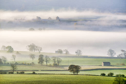 Mist rising over East Halton and Embsay in Lower Wharfedale, North Yorkshire, Yorkshire, England, United Kingdom, Europe - RHPLF11794