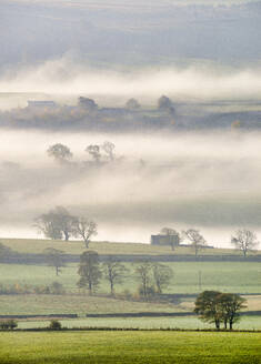 Mist rising over East Halton and Embsay in Lower Wharfedale, North Yorkshire, Yorkshire, England, United Kingdom, Europe - RHPLF11797