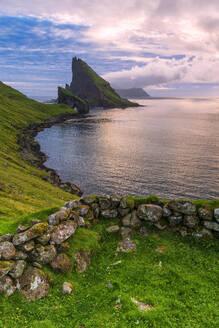 Sunset on the calm ocean and Drangarnir rock, Vagar island, Faroe Islands, Denmark, Europe - RHPLF12097
