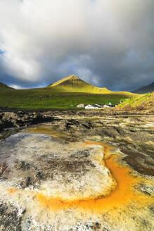 Rock formation in water, Gjogv, Eysturoy island, Faroe Islands, Denmark, Europe - RHPLF12109