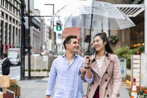 Happy couple with umbrella in Ginza, Tokyo, Japan - MCVF00019