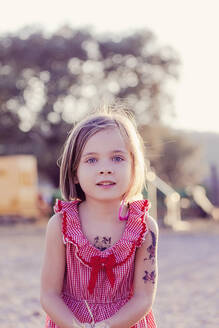 Portrait of little girl with temporary tattoos at sunset - XCF00226