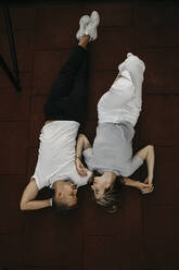 Young couple lying on the ground, from above - LHPF00861