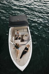 Top view of friends on a boat trip on a lake - LHPF00909