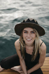 Portrait of smiling young woman on a boat - LHPF00936