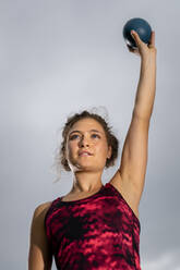 Femal shot-putter training with ball - STSF02258