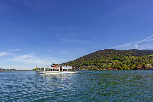 Ferry on Lake Tegernsee against blue sky during sunny day, Bavaria, Germany - LH00719