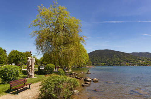 Scenic view of lake Tegernsee and mountains against blue sky during sunny day, Bavaria, Germany - LHF00722