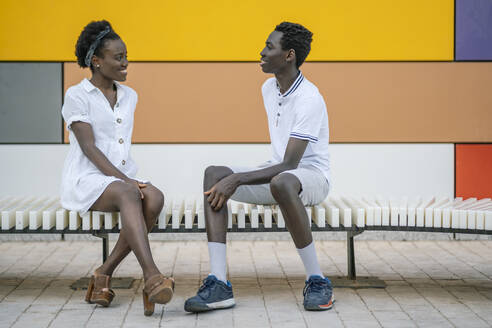 black couple in colorful and geometric background/SPAIN/ALICANTE/SAN JUAN - DLTSF00179