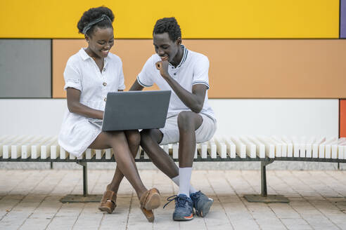 black couple in colorful and geometric background/SPAIN/ALICANTE/SAN JUAN - DLTSF00185