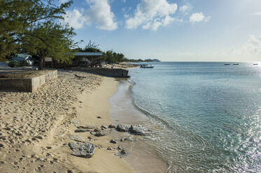Scenic view of sea against sky during sunny day at Cockburn town, Grand Turk - RUNF03225
